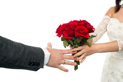 Bride offering rose bouquet to the groom Royalty Free Stock Image