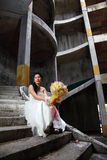 Bride on Old Rusty Stair Royalty Free Stock Images
