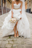 Bride on the old street of Lviv Stock Photography