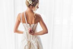 Bride opening her wedding dress Royalty Free Stock Image