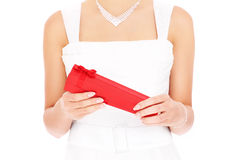 Bride opening red gift Stock Photo