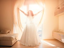 Bride opens the window. The bride opens the window royalty free stock photography