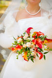 Bride with orange lilies Stock Photos