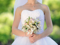 Bride with Orchid Bouquet Royalty Free Stock Image