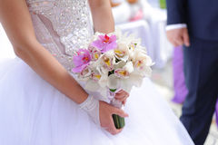 Bride with Orchids Royalty Free Stock Photography