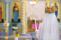 Bride in an orthodox church Stock Photos