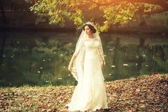 Bride outdoor in autumn Royalty Free Stock Photos