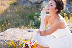 Bride outdoor portrait. Beautiful bride outdoor portrait on the stone Stock Photography