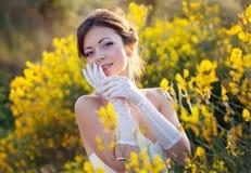 Bride outdoor portrait in flowers Stock Image