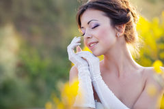Bride outdoor portrait in flowers Royalty Free Stock Image