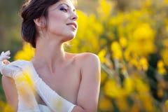 Bride outdoor portrait in flowers Stock Photo