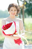 Bride outdoors with rose Stock Image