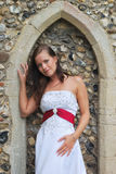 Bride outside Church under arch Royalty Free Stock Images