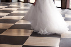 Bride over chequered floor Royalty Free Stock Image