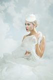 Bride over the sky background. Vintage style. Royalty Free Stock Image