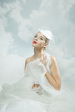 Bride over the sky background. Vintage style. Stock Photos