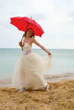 The bride with a parasol Stock Images