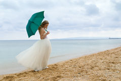The bride with a parasol Stock Photos