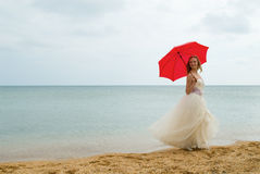 The bride with a parasol Royalty Free Stock Photos