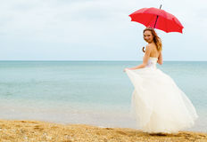 The bride with a parasol Stock Photo