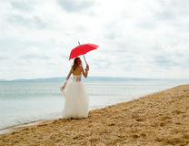 The bride with a parasol Stock Photography