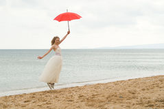 The bride with a parasol Royalty Free Stock Photo