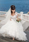 Bride in the park. Attractive young brunette bride on the quay Stock Images