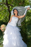 Bride in the park. Attractive young bride in the autumn park Royalty Free Stock Photography