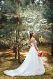Bride in park outdoors Stock Images