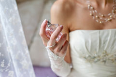 Bride and perfume Royalty Free Stock Photography