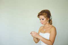 Bride with Perfume Bottle. Bride opening bottle with perfume Stock Photo