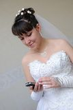 The bride with phone Stock Photography
