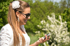 Bride with phone  Royalty Free Stock Photos