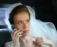 Bride with the phone Royalty Free Stock Photo