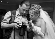 Bride and photographer. The beautiful bride and the photographer Royalty Free Stock Image