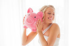 Bride with piggy bank being silly Royalty Free Stock Photos
