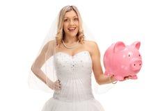 Bride with a piggybank Stock Photography