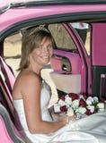 Bride in Pink Car Stock Image