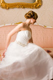 Bride and pink couch Stock Images