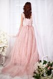 Bride in a pink dress with flowers Royalty Free Stock Photo