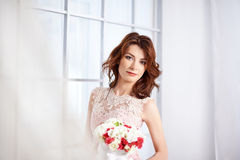Bride in a pink dress with flowers Stock Image