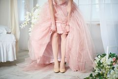 Bride in a pink dress with flowers Royalty Free Stock Image