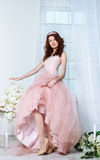 Bride in a pink dress with flowers Stock Photo