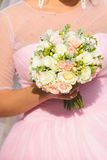 Bride in Pink with Flowers Stock Images