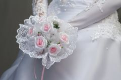 Bride with pink flowersbouquet Stock Photography