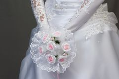 Bride with pink roses bouquet Stock Photo