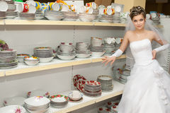 Bride in plates section of a store Royalty Free Stock Image