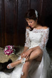 Bride playing with her garter Royalty Free Stock Photography
