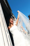 Bride playing with her veil Stock Images