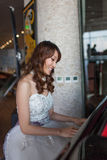 Bride is playing piano Stock Image